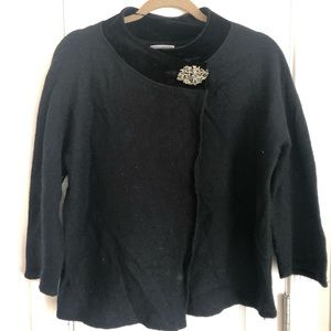 Black cape with brooch